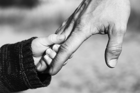 child-holding-fathers-hand